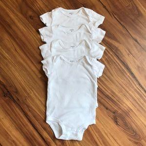Carter's 4 pack of white short-sleeve onesies.